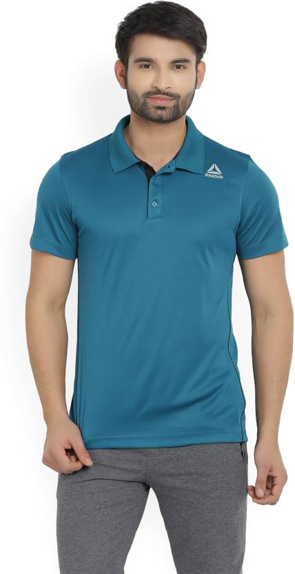 38847125 REEBOK Solid Men Polo Neck Dark Blue T-Shirt