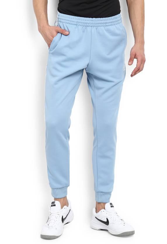 c3961770a ADIDAS ORIGINALS Solid Men's Light Blue Track Pants - Buy Blue ADIDAS  ORIGINALS Solid Men's Light Blue Track Pants Online at Best Prices in India  ...