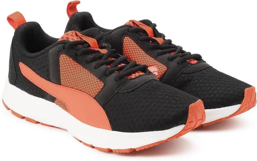 lowest price 9656c c51cb Puma Deng IDP Running Shoes For Men (Black, Orange)
