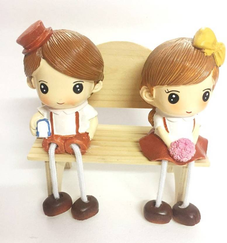 14accdd38b5d INDOGIFTS Beautiful Showpiece of Boy and Girl in Small Size Sitting on  Wooden Bench Size 12 x 12 x 7 cm Decorative Showpiece - 12 cm (Polyresin,  Multicolor)