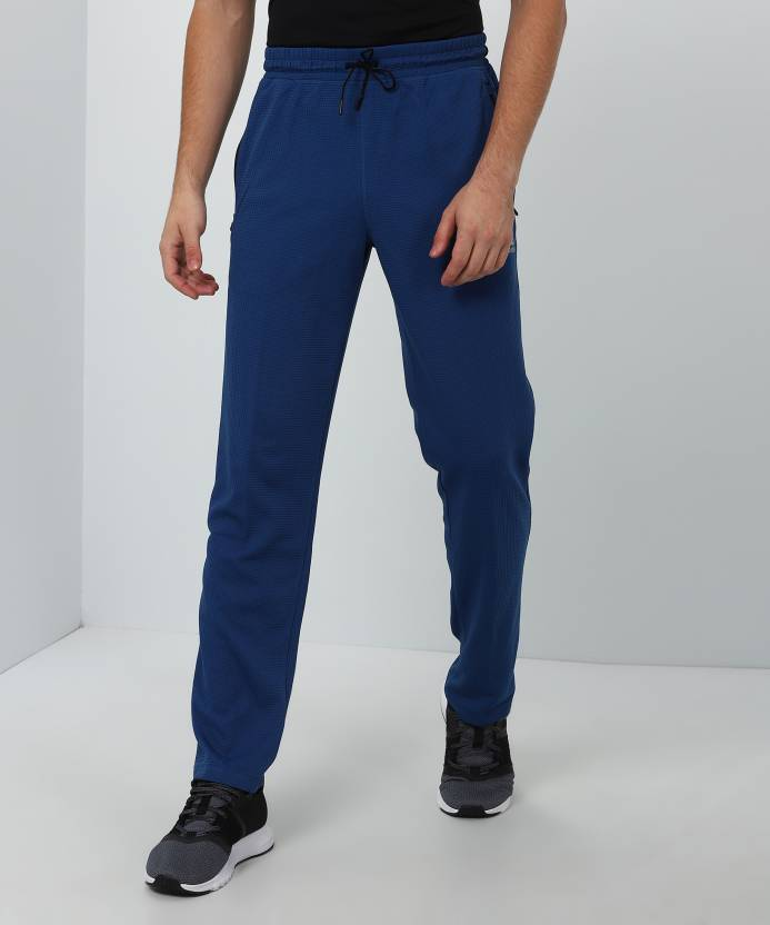 5360e9ed0301 REEBOK Solid Men Blue Track Pants - Buy REEBOK Solid Men Blue Track Pants  Online at Best Prices in India