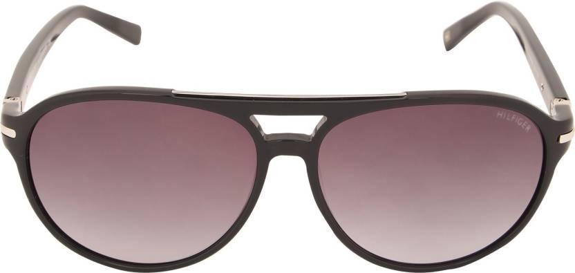 c52eb4b9dd37 Buy Tommy Hilfiger Oval Sunglasses Brown For Men & Women Online ...