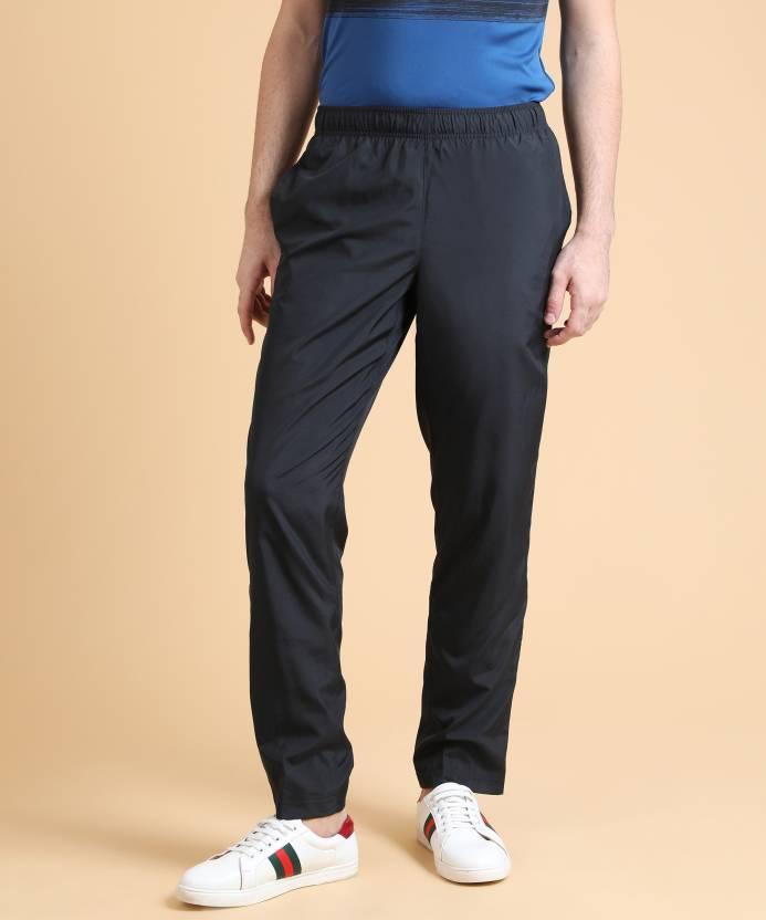 e3c66e01 REEBOK Solid Men Black Track Pants