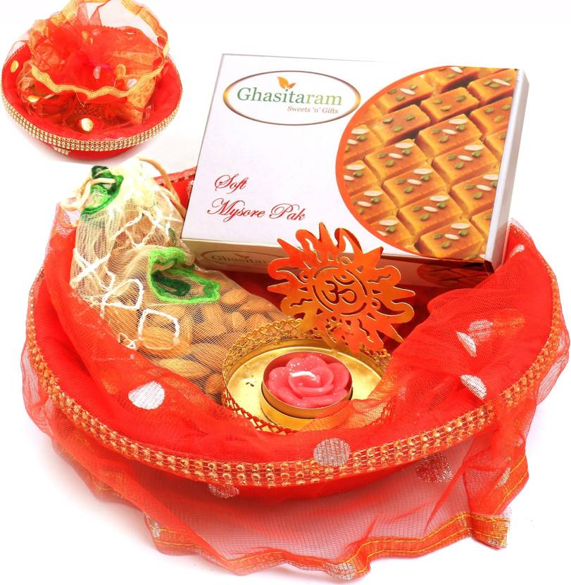 Ghasitaram Gifts Red Potli Basket with Mysore Pak and Almonds Pouch and Om T- lite