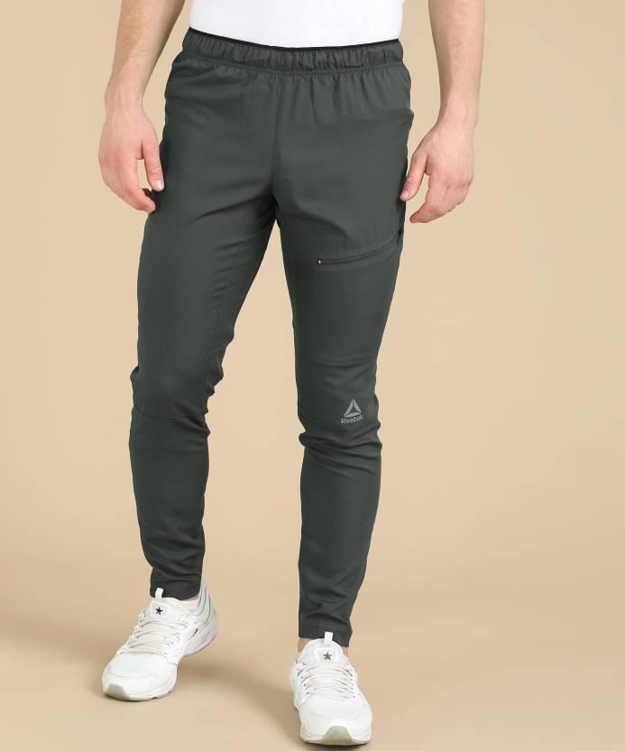 c3f81273de64 REEBOK Solid Men Grey Track Pants - Buy REEBOK Solid Men Grey Track Pants  Online at Best Prices in India