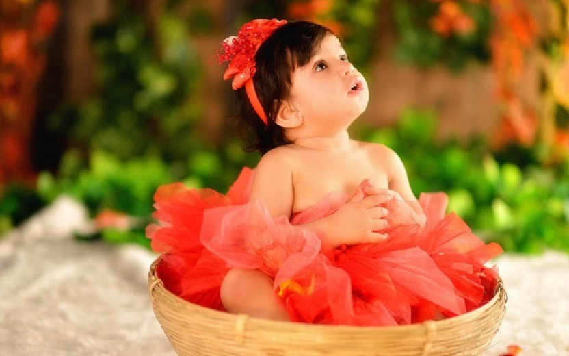 Cute baby girl think, that