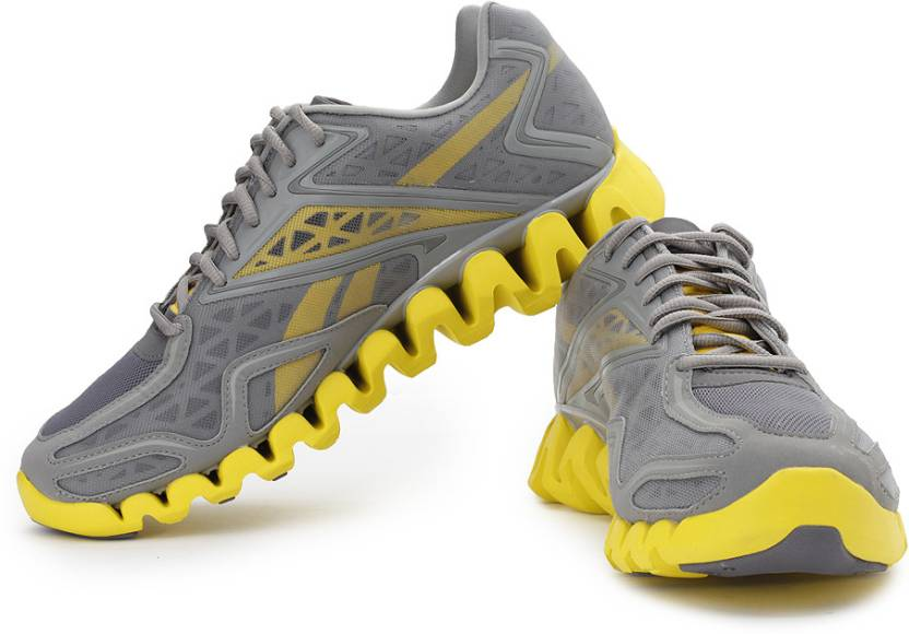 outlet store 2c417 f7276 REEBOK Zigsonic Running Shoes For Men (Grey, Yellow)