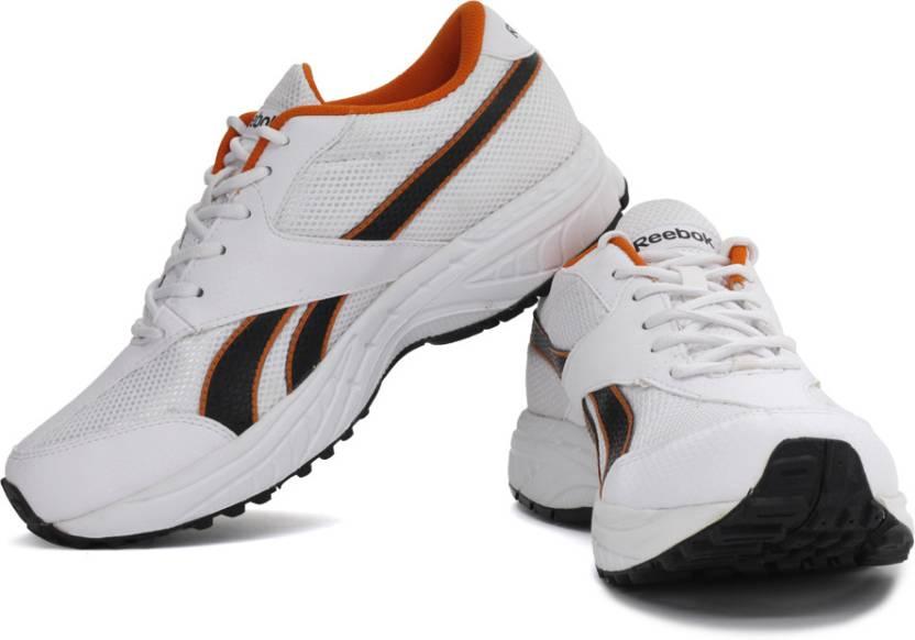 d9a86280d662 REEBOK Rapid Runner LP Running Shoes For Men - Buy White